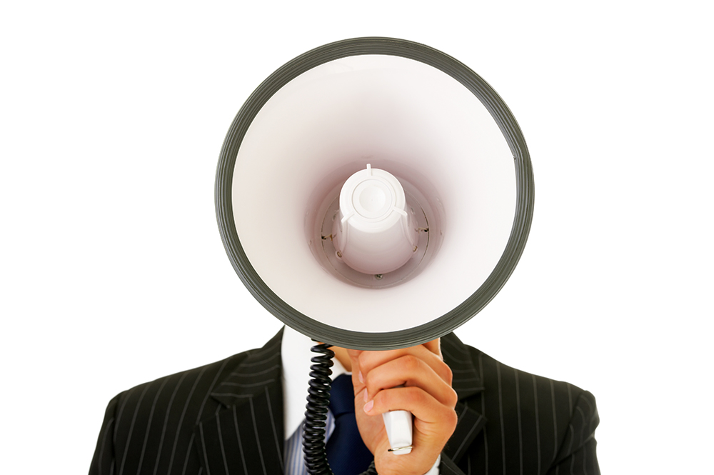 Portrait of a  man talking into a megaphone